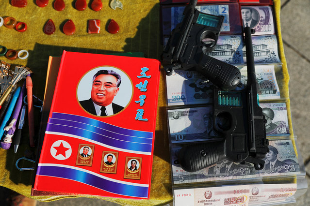 North Korean souvenirs are displayed for sale on the banks of the Yalu River in Dandong in Liaoning province, China, November 19, 2017. In the Chinese city of Dandong, signs of neighbouring North Korea are pervasive. (Photo by Damir Sagolj/Reuters)