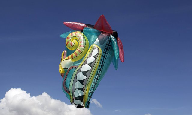A Quetzalcoatl balloon, measuring 60 feet, is seen flying during the 14th Solar Balloon Festival in Envidago December 31, 2014. (Photo by Fredy Builes/Reuters)