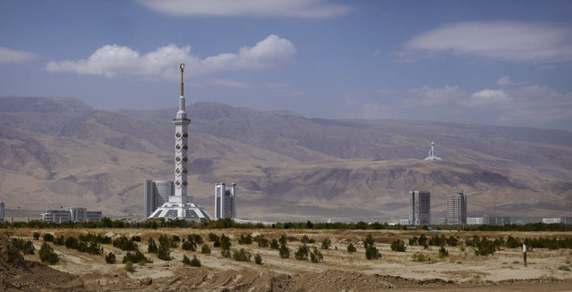 The 600ft Constitution Monument in Ashgabat, with the Tele-radio Center in background. (Photo by Amos Chapple via The Atlantic)
