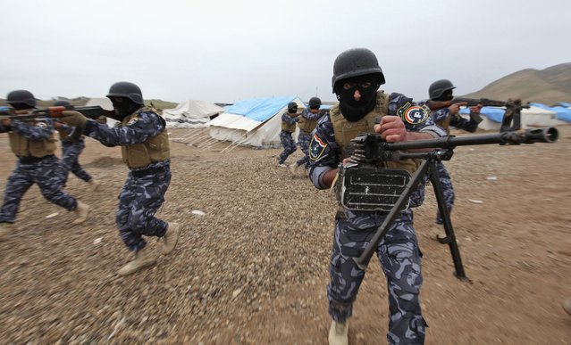 Members of the Iraqi security forces take part in training, as they prepare to fight against militants of the Islamic State, at a training camp on the outskirts of Mosul January 10, 2015. (Photo by Azad Lashkari/Reuters)