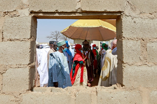 People are seen through a window as they attend the traditional wedding ceremony of Emir's 7 children in Abuja, Nigeria, December 26, 2020. (Photo by Afolabi Sotunde/Reuters)
