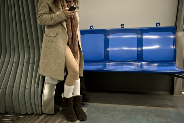A girl rides on a train as she takes part in the first edition of the No Pants Subway Ride in Bucharest, Romania, Sunday, January 11, 2015. (Photo by Vadim Ghirda/AP Photo)