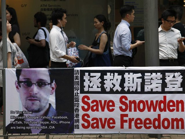 """""""The state-controlled Chinese media is lauding Edward Snowden's conduct as the definition of heroism"""". (Photo by Bobby Yip/Reuters)"""