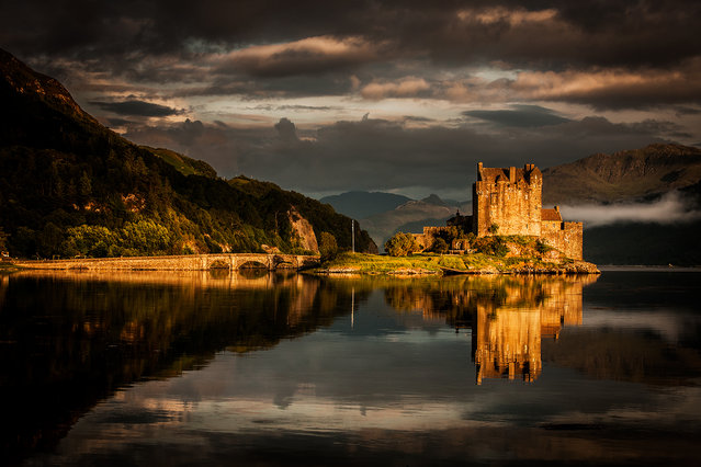 """Elean Donan Castle"". Many photos of this castle are made, but this one has a last shine of the sun on rocks and stone, separating the castle from the landscape. (Photo and caption by Frank Heumann/National Geographic Traveler Photo Contest)"