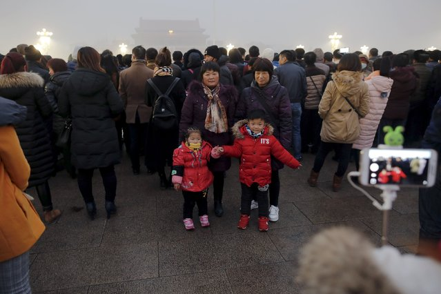 "People gather at the Tiananmen Square for a flag-raising ceremony amid heavy smog, after the city issued its first ever ""red alert"" for air pollution, in Beijing December 9, 2015. (Photo by Damir Sagolj/Reuters)"