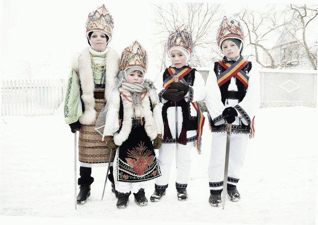 Children celebrate the winter festival of Malanka in Krasnoilsk. (Photo by Aude Osnowycz/Hans Lucas/The Guardian)