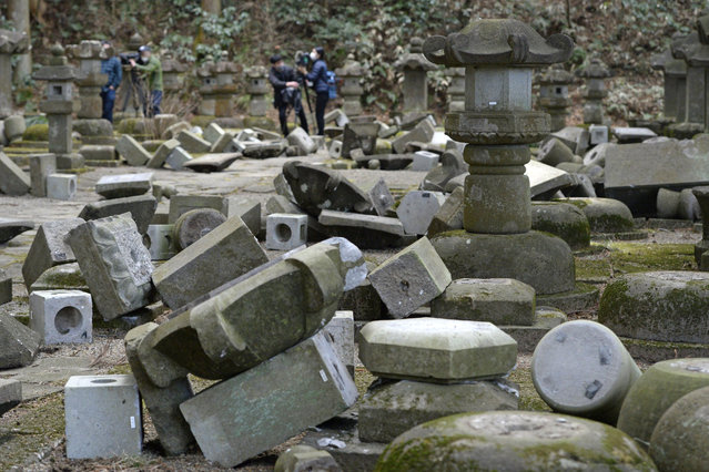 Stone lanterns lie collapsed after a strong earthquake at a graveyard near the entrance to the Zuihoden mausoleum complex in Sendai, Miyagi prefecture, northern Japan, Sunday, February 14, 2021. The temblor late Saturday shook the quake-prone areas of Miyagi and Fukushima prefectures. (Photo by Yohei Nishimura/Kyodo News via AP Photo)