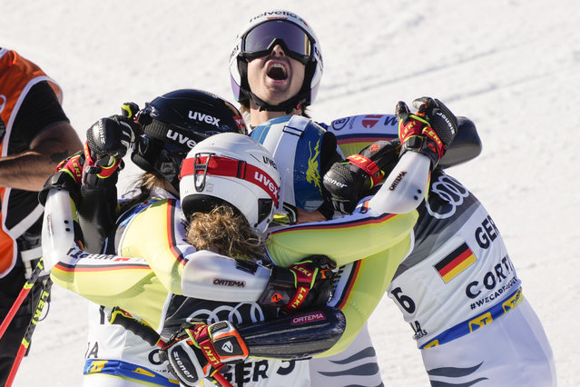 Germany team celebrates winning bronze medal in the mixed team parallel slalom, at the alpine ski World Championships in Cortina d'Ampezzo, Italy, Wednesday, February 17, 2021. (Photo by Giovanni Auletta/AP Photo)