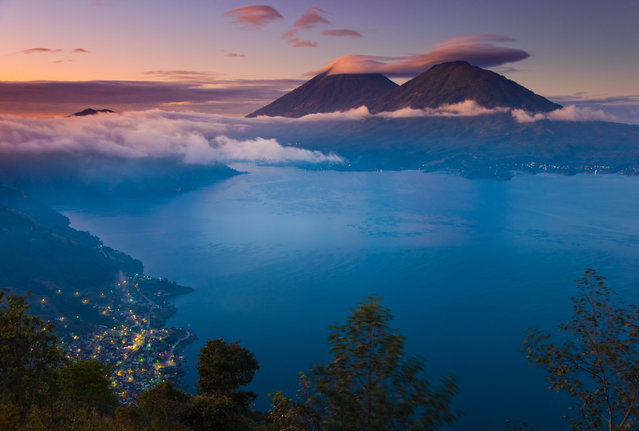 View of Lake Atitlan, with Toliman and Atitlan volcanoes in the background, Toliman and San Pedro, Guatemala. (Photo by DeAgostini/Getty Images)