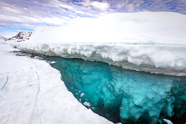 A topside view of the iceberg. (Photo by Franco Banfi/Caters News Agency)