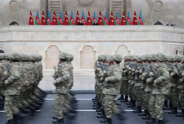 A handout picture taken and released on December 10, 2020 by the Turkish presidential press service shows Turkish President Recep Tayyip Erdogan and Azerbaijani President Ilham Aliyev attending a military parade marking Azerbaijan's victory against Armenia in their conflict for control over the disputed Nagorno-Karabakh region, in Baku. (Photo by Mustafa Kamaci/Turkish Presidential Press Office via Reuters)