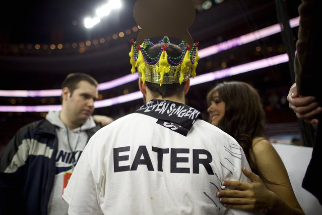 """Patrick """"Deep Dish"""" Bertoletti speaks to the media after winning the 23rd annual Wing Bowl at the Wells Fargo Center in Philadelphia, Pennsylvania January 30, 2015. (Photo by Mark Makela/Reuters)"""