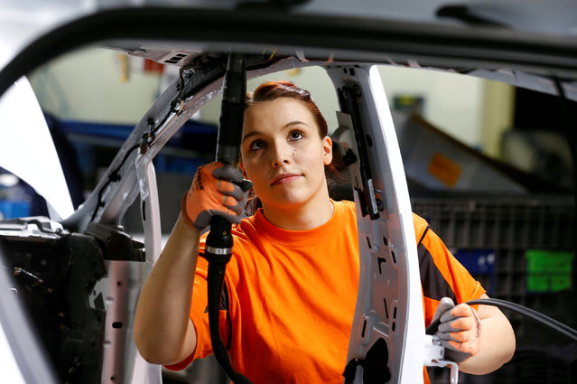 A woman is pictured at work at the Ford Fiesta assembly line in Cologne, Germany, January 6, 2016. (Photo by Wolfgang Rattay/Reuters)