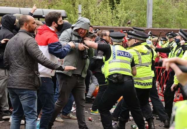 Manchester United fans clash with police officers in protest against their owners outside the stadium before the Manchester United v Liverpool Premier League match in Manchester, Britain on May 2, 2021. (Photo by Carl Recine/Action Images via Reuters)