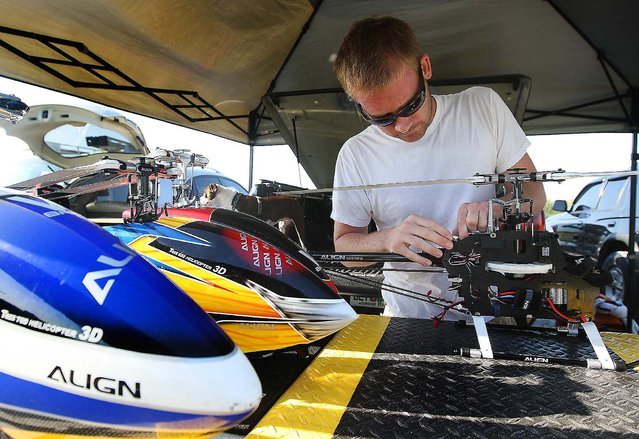Phil Dettman prepares one of his electric flybarless 3-axis gyro helicopters. (Photo by Bill Ingram/The Palm Beach Post)