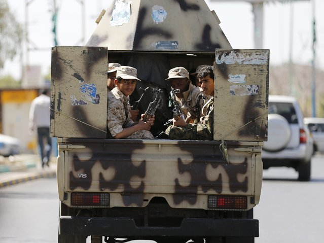 Houthi fighters ride a patrol vehicle outside a hotel hosting U.N.-sponsored negotiations on a political settlement for Yemen's crisis in Sanaa February 19, 2015. Yemen is slipping further into chaos as the Houthis, an Iranian-backed Shi'ite Muslim militia from the north, consolidate their grip on power after seizing the capital in September and sidelining the central government. (Photo by Khaled Abdullah/Reuters)