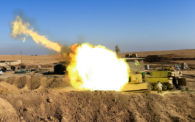 Iraqi army fires towards Islamic State militant positions in Mosul from the village of Adhbah, south of Mosul Iraq, December 6 2016. (Photo by Thaier Al-Sudani/Reuters)