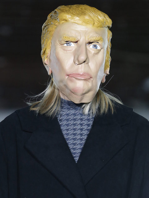 A model wearing a mask bearing a likeness to US presidential candidate Donald Trump presents a creation during the Fall/Winter 2016/17 Men's collection by Avoc fashion house during the Paris Fashion Week, in Paris, France, 20 January 2016. The presentation of the Men's collections run from 20 to 24 January. (Photo by Ian Langsdon/EPA)