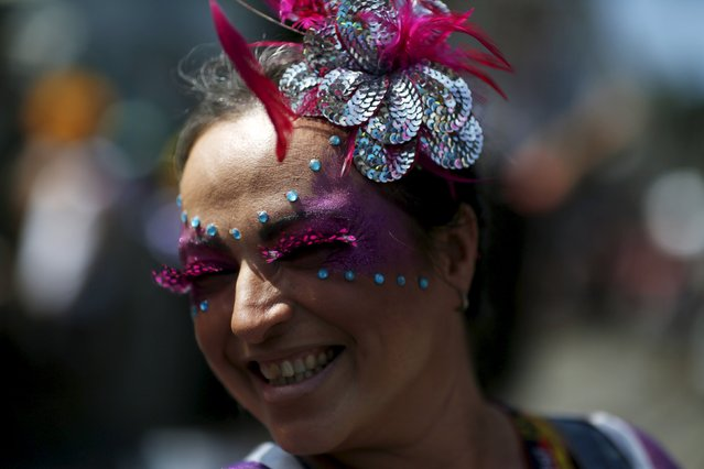 """A reveller takes part in an annual block party known as """"Ceu na Terra"""" (Heaven on Earth), one of the many carnival parties to take place in the neighbourhoods of Rio de Janeiro, January 30, 2016. (Photo by Pilar Olivares/Reuters)"""
