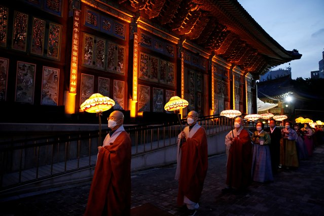 Buddhist monks and believers attend a lantern parade in celebration of the upcoming birthday of Buddha at a temple in Seoul, amid the coronavirus disease (COVID-19) pandemic, in Seoul, South Korea, May 6, 2021. (Photo by Heo Ran/Reuters)