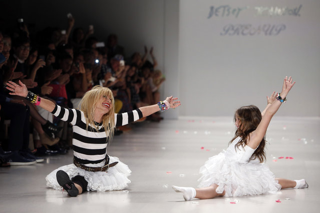 In this Wednesday, Sept. 10, 2014,  file photo, designer Betsey Johnson, left, does a split after cartwheeling with her granddaughter, Layla Margulies, 8, during the finale of her Spring 2015 fashion show during Fashion Week in New York. (Photo by Jason DeCrow/AP Photo)