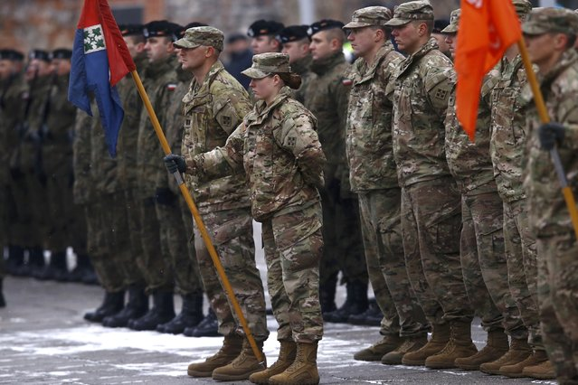 U.S. and Polish army soldiers attend an official welcoming ceremony for U.S. troops deployed to Poland as part of NATO build-up in Eastern Europe in Zagan, Poland, January 14, 2017. (Photo by Kacper Pempel/Reuters)