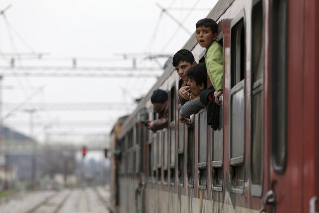 Migrants look out from a train near the Macedonian-Greek border in Gevgelija, Macedonia February 24, 2016. (Photo by Marko Djurica/Reuters)