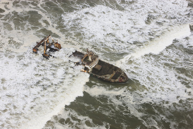 An aerial view aerial view of shipwreck Zeila which stranded in 2008, in October, 2014, in the Namib Desert, Namibia. (Photo by Theo Allofs/Barcroft Media)