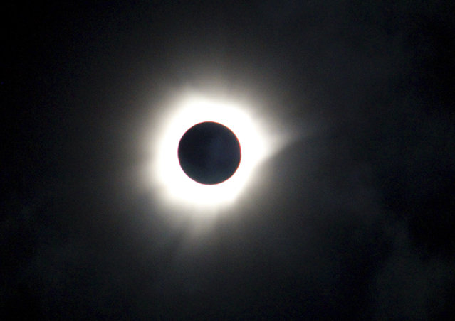 A total solar eclipse is seen in Luwuk, Central Sulawesi, Indonesia, Wednesday, March 9, 2016. A total solar eclipse was witnessed along a narrow path that stretched across Indonesia while in other parts of Asia a partial eclipse was visible. (Photo by AP Photo/Irmansyah)