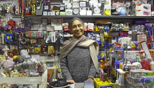 "Rekha Shah, 67, poses for a photograph at her workplace, Everything etc, in the London constituency of Brent Central, Britain, April 3, 2015. Shah, who was born in Kenya, said: ""I'll be frank. I don't know a lot about politics but I hope whoever gets in does a little more for the little shops"". (Photo by Eddie Keogh/Reuters)"