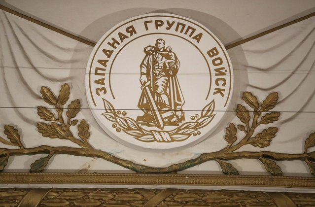 """A seal in Russian reads: """"Western Group of the Armed Forces"""" above the stage in the theater and cinema in the officers' building at the former Soviet military base on January 26, 2017 in Wuensdorf, Germany. (Photo by Sean Gallup/Getty Images)"""