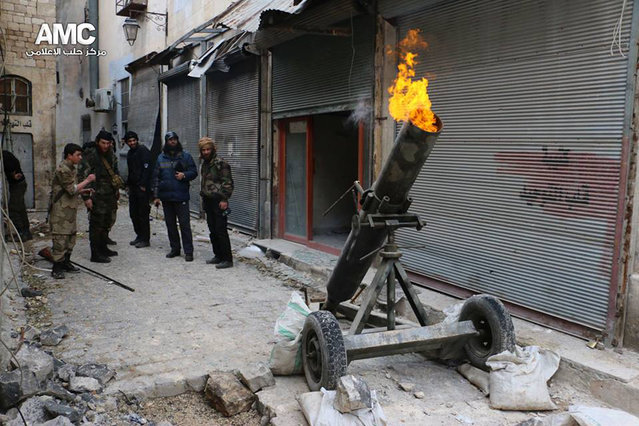 This file photo provided on Sunday February 15, 2015 by the Syrian anti-government activist group Aleppo Media Center (AMC), which has been authenticated based on its contents and other AP reporting, shows Syrian rebels firing locally made shells against the Syrian government forces, in Aleppo, Syria. (Photo by AP Photo/Aleppo Media Center)