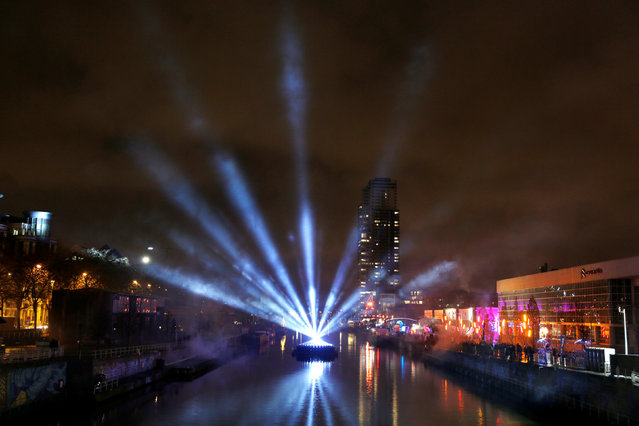 An artistic light installation illuminates the Brussels-Charleroi canal during the Bright Brussels Festival, Belgium, February 4, 2017. (Photo by Francois Lenoir/Reuters)