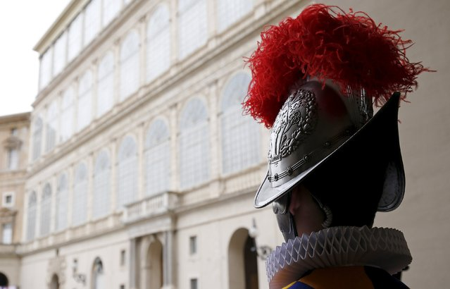 A new recruit of the Vatican's elite Swiss Guard stands at attention during the swearing-in ceremony at the Vatican May 6, 2015. The Swiss Guard, founded in 1506, consists of 100 volunteers who must be of Swiss nationality, Catholic, single, at least 174 cm (5.7 ft) tall and without a beard. New recruits are sworn in every year on May 6 to commemorate the day where 147 Swiss soldiers died defending the Pope during an attack on Rome in 1527. (Photo by Giampiero Sposito/Reuters)