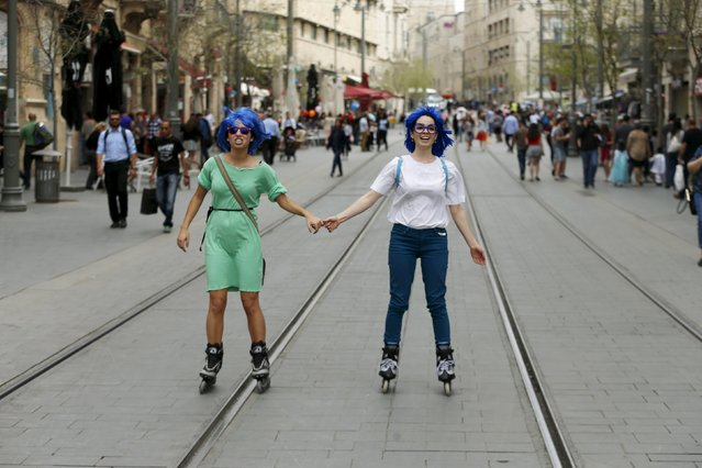 Women wear wigs and roller blades as they mark the Jewish holiday of Purim in Jerusalem March 24, 2016. (Photo by Ammar Awad/Reuters)