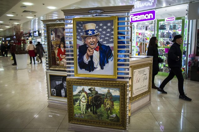 A caricature picture showing U.S. President Donald Trump on sale in a shopping mall in Moscow, Russia, Wednesday, February 15, 2017. The picture costs 70,000 rubles (about $1,200). As President Donald Trump has become increasingly mired in internal political battles, the Kremlin is patiently waiting for him to deliver on his promises to mend ties with Russia weighing its statements to avoid jeopardizing a chance for a thaw. (Photo by Alexander Zemlianichenko/AP Photo)