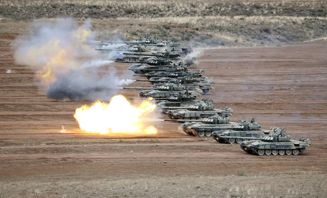 T-72B tanks fire during military exercises at the firing ground Koktal in Almaty Region, Kazakhstan on May 3, 2019. (Photo by Pavel Mikheyev/Reuters)