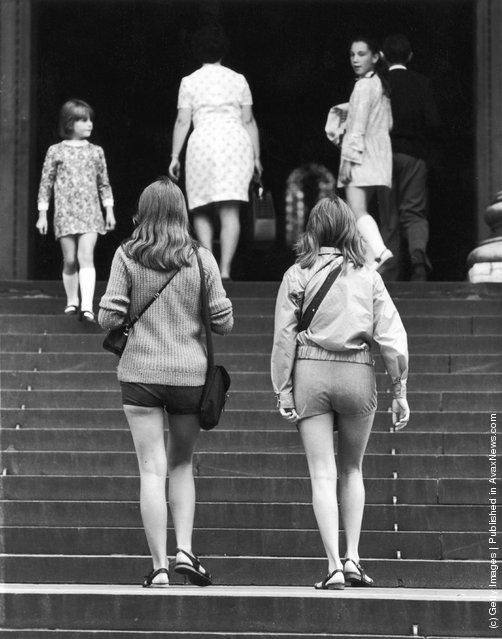 Female visitors in hot pants entering St Paul's Cathedral, London, 1971