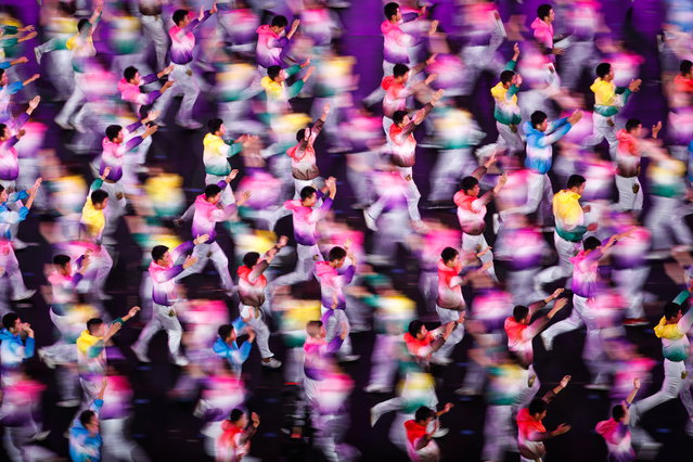 Performers in action during the Asian Culture Carnival at the National Stadium (The Bird's Nest) in Beijing, China, 15 May 2019. Around 8,000 performers from different countries including China, South Korea, and Japan took part in the Asian Culture Carnival. The Carnival is the part of The Conference on Dialogue of Asian Civilizations event which China hosts from 15 May. (Photo by Roman Pilipey/EPA/EFE)