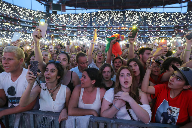 Fans cheer the english singer Ed Sheeran during his performance on stage at Luz Stadium, Lisbon Portugal, 01 June 2019. (Photo by Miguel A. Lopes/EPA/EFE)