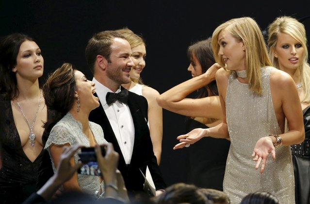 U.S. actress Eva Longoria (2nd L) and U.S. fashion designer Tom Ford (3rd L) joke with U.S. model Karlie Kloss (2nd R) as they conduct an auction during the amfAR's Cinema Against AIDS 2015 event during the 68th Cannes Film Festival in Antibes, near Cannes, southern France, May 21, 2015. (Photo by Regis Duvignau/Reuters)