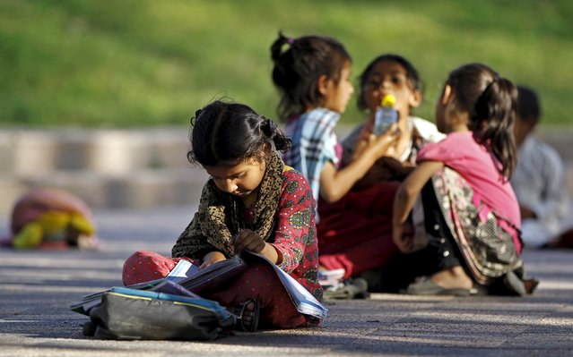 Children study between their classes at a local park in Islamabad April 22, 2015. (Photo by Caren Firouz/Reuters)