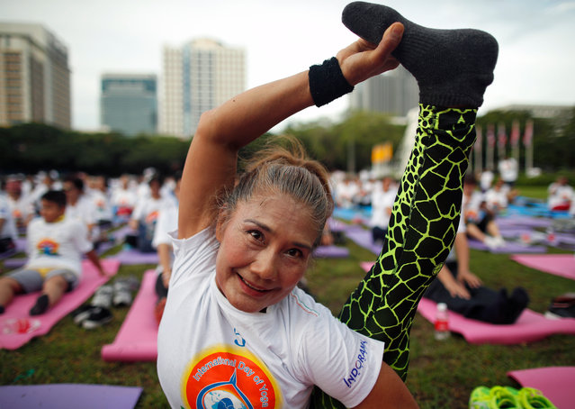 A Thai Yoga enthusiast performs during a mass yoga exercise in Bangkok, Thailand, 16 June 2019. Hundreds of Thai and foreign Yoga enthusiasts took part in the mass Yoga exercise organized by the Indian embassy to mark the International Day of Yoga which annually celebrated on 21 June. (Photo by Rungroj Yongrit/EPA/EFE)