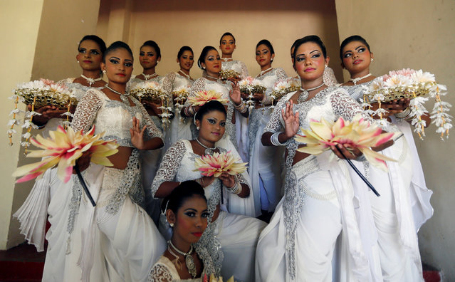 A group of female traditional dancers pose for photographs during International Women's Day celebrations in Colombo, Sri Lanka, March 8, 2017. (Photo by Dinuka Liyanawatte/Reuters)