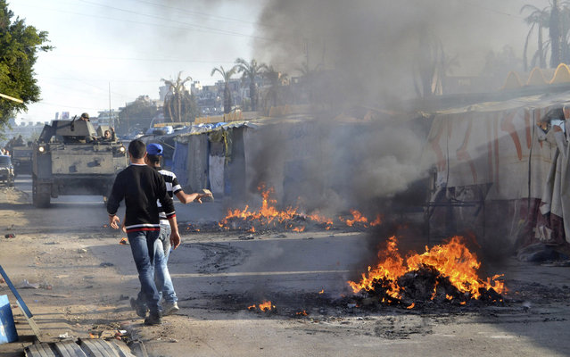 Sunni Muslim protesters set fire, blocking a road in the northern city of Tripoli, to protest against the Lebanese army's ongoing raids that are part of their security plan for the city in a push to control sectarian violence fuelled by the war in Syria April 8, 2014. (Photo by Reuters/Stringer)