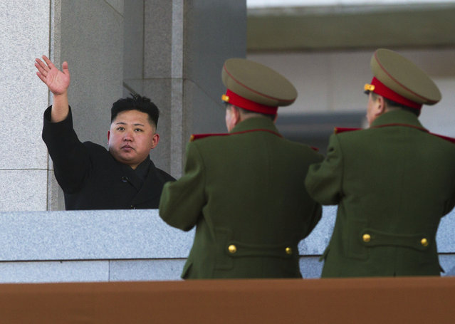 New North Korean leader Kim Jong Un waves at Kumsusan Memorial Palace in Pyongyang after reviewing a parade of thousands of soldiers and commemorating the 70th birthday of his late father Kim Jong Il on Thursday, February 16, 2012. (Photo by David Guttenfelder/AP Photo)