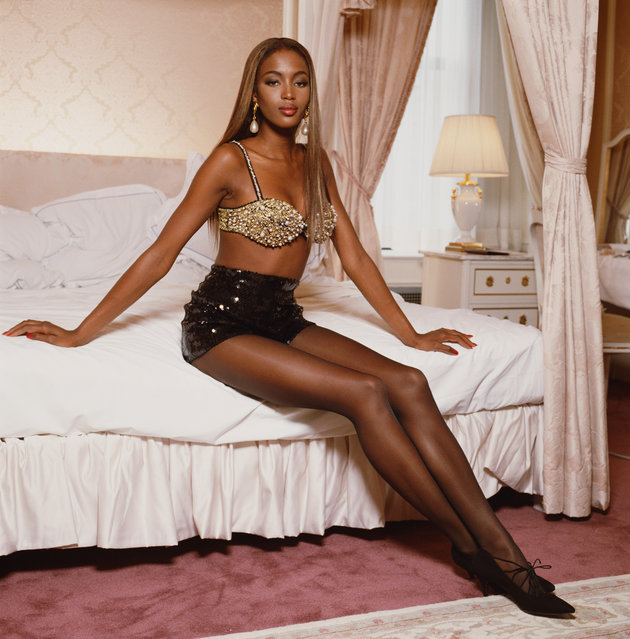 British supermodel Naomi Campbell, wearing a pearl encrusted bra top, posing in a hotel room in New York, August 1991. (Photo by Terry O'Neill/Iconic Images/Getty Images)