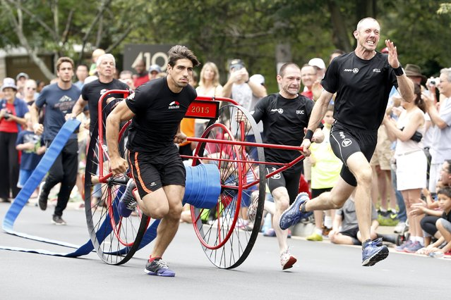 Members of a Belgian team from Brussels sprint with a fire hose during the hose cart competition of the Firefighter Muster event at the World Fire and Police Games in Fairfax, Virginia July 4, 2015. Organizers said thousands of police and firefighter athletes from about 70 countries competed in traditional sports as well as events meant to show their skill as first responders during the 10-day meet. (Photo by Jonathan Ernst/Reuters)