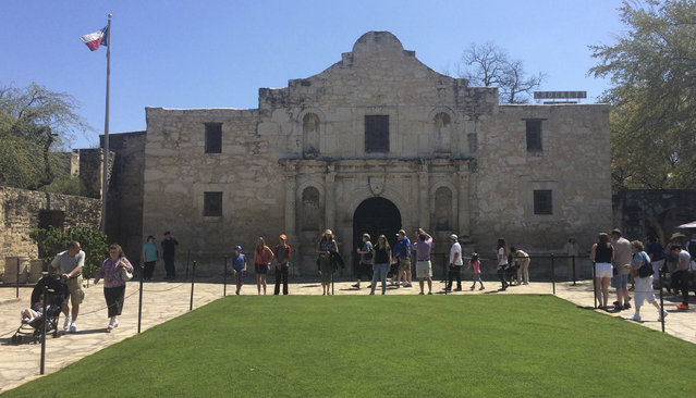 The Alamo: Visitors walk at the entrance to the Alamo, the most-visited tourist site in the state, in San Antonio, Texas March 2, 2015. (Photo by Lisa Maria Garza/Reuters)