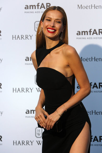 Model Petra Nemcova, of the Czech Republic, smiles as she arrives for the AMFAR dinner, Sunday July 5 2015 in Paris, France. (Photo by Rafael Yaghobzadeh/AP Photo)